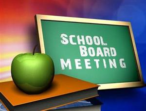 School Board Meeting Sign Green Apple on Desk